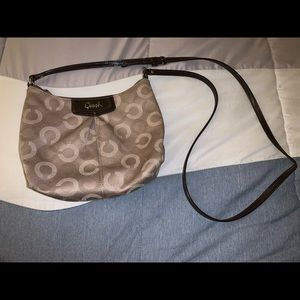 Brown Coach crossbody bag with pink interior